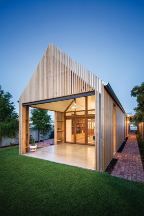 The extension's silvertop ash cladding and oak batten sunshading hint at the pared-back, Scandinavian-inspired spaces inside.