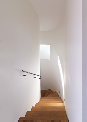 The central stairwell of Darling Point House winds up to a rooftop pavilion.