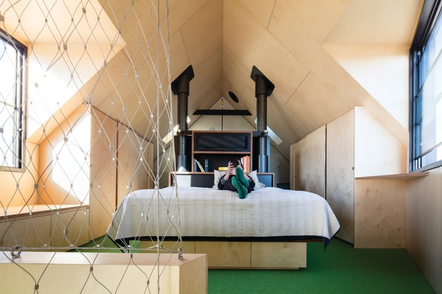 The angles of the roof line create a loft-like bedroom that is aligned to be on axis with the Eureka Tower.