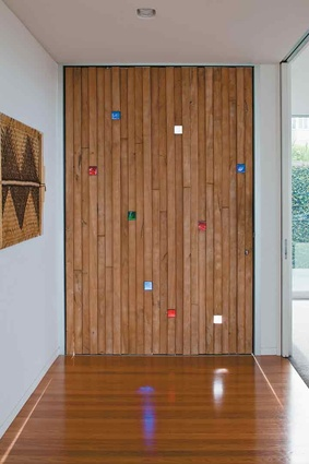 The totara front door - with glass inserts designed by Carin Wilson.