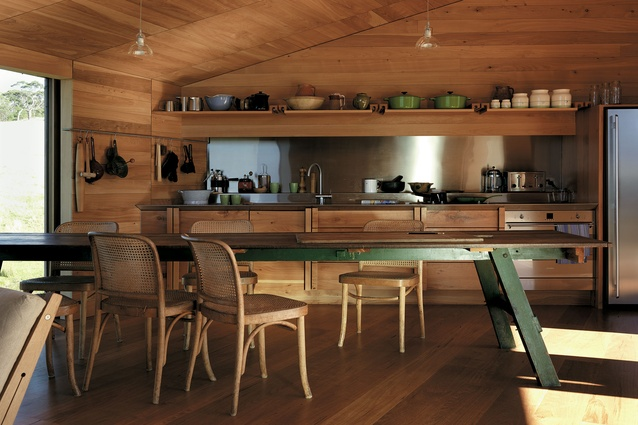 Pots and bowls on display provide another layer of materiality in this timber kitchen in the Shearer's Quarters by John Wardle Architects, seen in the Houses Awards.