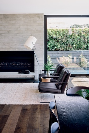 Living room furniture includes the Leman Armchair from Bauhaus and Fork Lamp by Diesel.