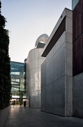 On three sides the theatre features a simple exterior cladding of timber and glass.