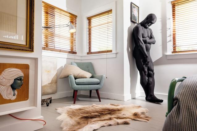<em>Rest</em> leans in a corner of the bedroom.