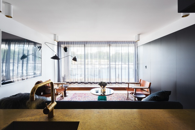 """A brass kitchen bench is one of the defining elements of Apartment Finger Wharf, which was designed as a """"comfortable, homey hotel."""""""