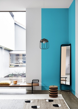 Black and white is an important combination while greyed-off tertiary hues are paired with saturated colours including teal.