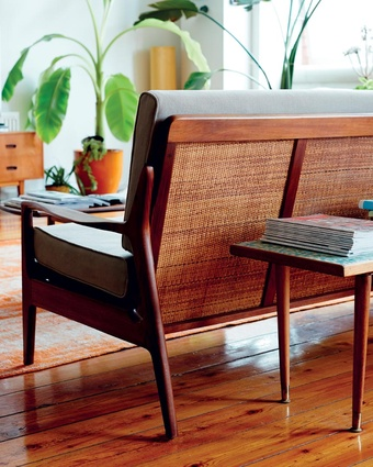 """Caneback couch: """"We found this couch and some chairs at a vintage store in Brisbane. We had it reupholstered and the wood repaired and I'm so happy we did. The back is my favourite feature""""."""