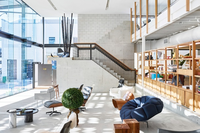 The double-height Living Edge showroom employs elements reminiscent of public or urban spaces, such as the ramp, giant staircase and balcony.