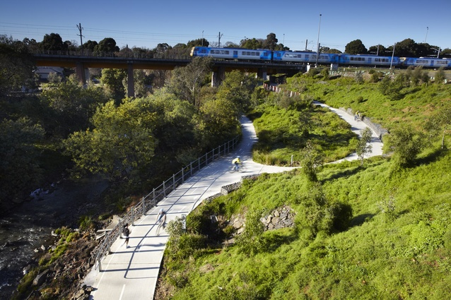 View of south bank from High Street Bridge. New Merri Creek Trail and ramp access addressing the grades of the site.