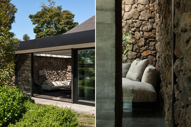 Volcanic stones from the site were used to create a feature wall that runs throughout this Mount Eden home.