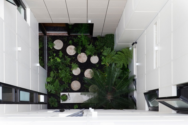 Apartments overlook internal courtyards, ensuring access to natural light and ventilation.