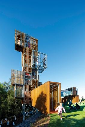 The tree house of timber-slat boxes and wire cages, by JMD Design.