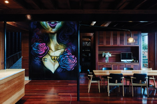 A large-scale mural by prominent street artist Sofles is featured in the dining area, adding a punch of vibrancy.