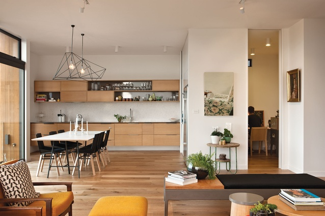 The generous living space is softened with timber floors and kitchen and a mix of contemporary and vintage furniture.