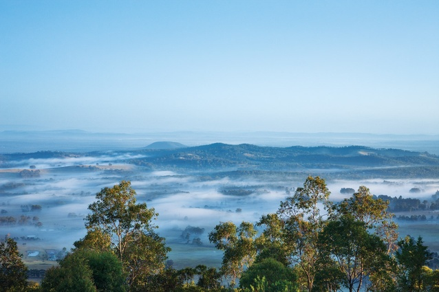 Early morning cloud blankets the majestic valley below.