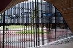 Curved concertina trellis security doors secure Infinity Centre