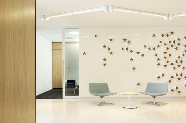 Reception waiting area with meeting rooms beyond.
