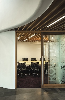 Timber-framed joinery proliferates in the building. The limited colour palette runs through the building's hard surfaces; materials include black-oxide-coloured concrete, Sto plaster and black tiles.