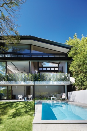 A secondary living room on the lower level extends into the pool and backyard area.