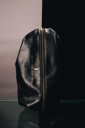 The leather is matched with slim line zips and brass detailing.