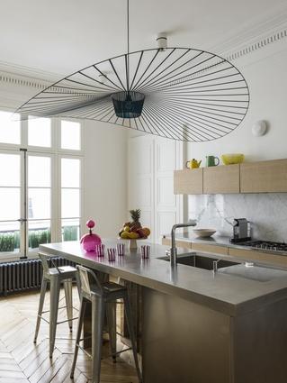 The kitchen features Constance Guisset's Vertigo lighting.