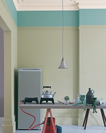 Grey-green Mizzle by UK company Farrow & Ball, used below the picture rail on this kitchen's walls, changes with the light.