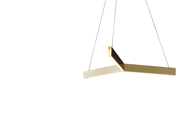 The Tri Pendant by Resident Studio has a classic geometric shape.