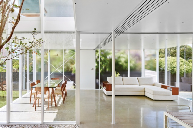 Large, well-concealed sliding doors provide the option of enclosing the otherwise openplan kitchen, living and dining spaces.