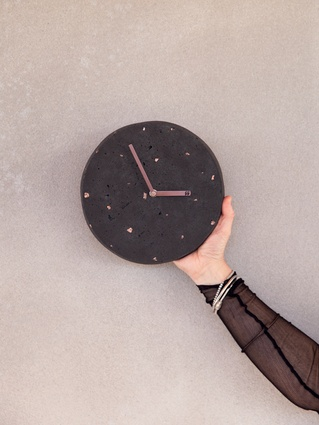 """This concrete clock is limited edition and handmade by Greer Garner, who works with Kate. We like that each clock is unique and they blur the lines between functional homeware and art,"" says Craig."