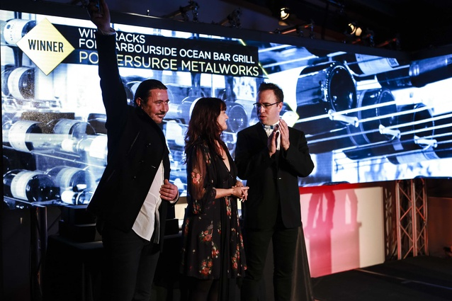 Todd Stevenson and Andrea Harradine receiving Craftsmanship Award from Federico Monsalve, editor <em>Interior</em>.