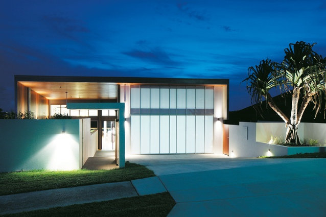 The milky polycarbonate panels on the garage door give the house a contemporary aesthetic.