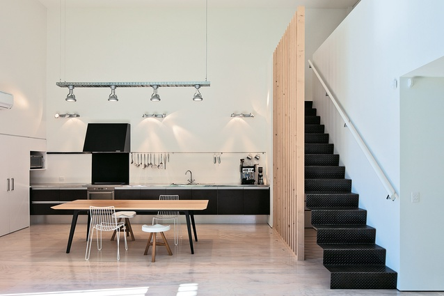 A dining table and chairs from Simon James Design fit comfortably into the linear kitchen.
