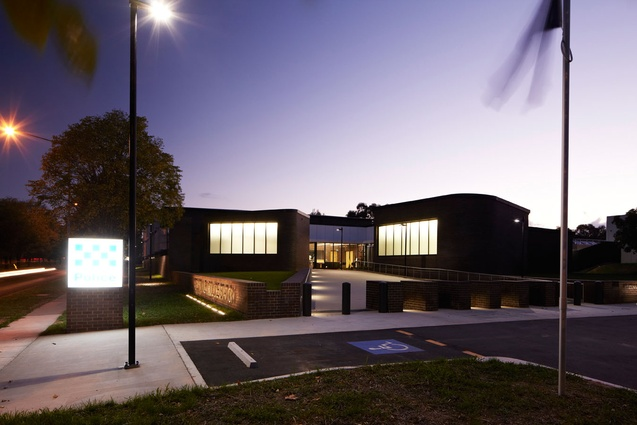 The exterior of the Belconnen Police Station at night.