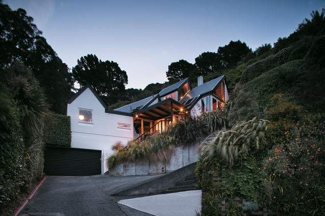 The Kimber's Seatoun home from the road. Its roofline follows the shape of the slope it is built into.