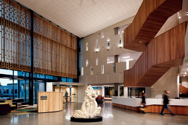 Burwood Hospital's new foyer is rich in texture, culture and architecture, featuring a curvaceous timber stairwell, a striking carving by artist Riki Manuel and a cosy lounge area.