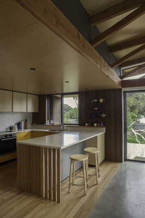 Pitoitoi House kitchen, which showcases some of the crafted timber elements that feature throughout the home.