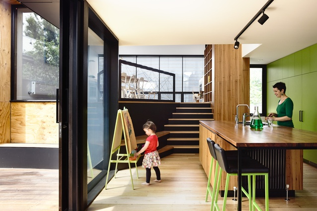 An integrated stair/joinery spine connects the lower level kitchen and upper level spaces.