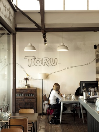 An interior view of Toru, a natural and contemporary styled café that sits comfortably under the rustic and industrial influences.
