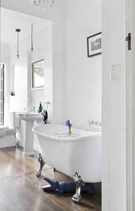 "Claw-foot bath: ""It came with the house and was one of the things we loved at first sight.'' The period fittings, overhead chandelier, wooden flooring and outlook make it a relaxing retreat-within-a-retreat."