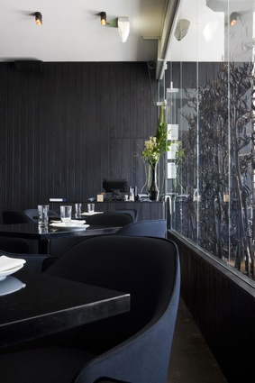 Dark tones add commute an elegance and refinement to the restaurant.