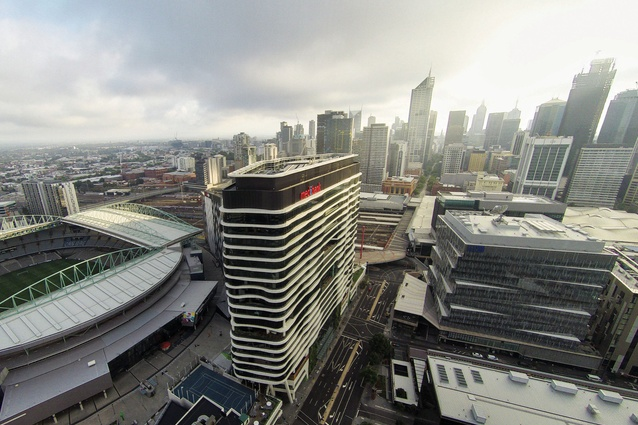 The building sits on a narrow, triangular site just south of Etihad Stadium and a 600-metre walk away from Southern Cross Station.