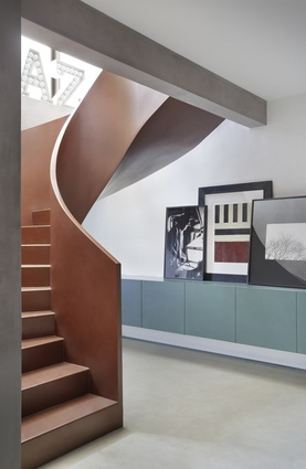 One of the apartment's most poignant moments is at the stair's landing where the sculptural meets traditional Moorish, meets industrial and contemporary.