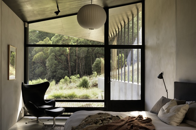House at Hanging Rock. Surrounded by the bush and boasting views of neighbouring Hanging Rock, the home features a largely concrete palette and Armourply joinery.