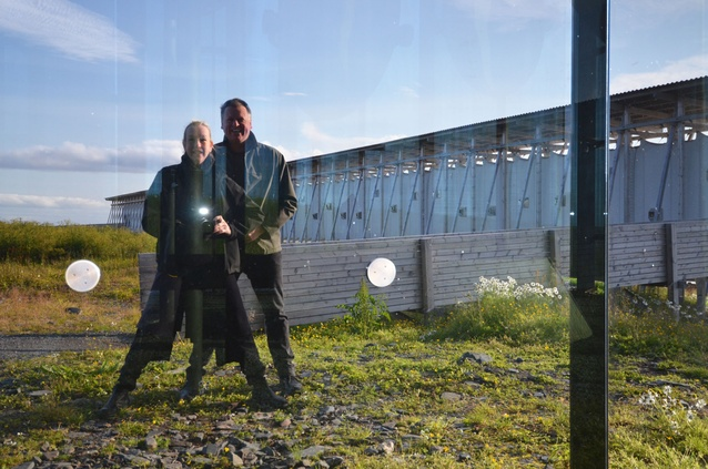 Lindy Atkin and Stephen Guthrie reflected in the witchcraft memorial.