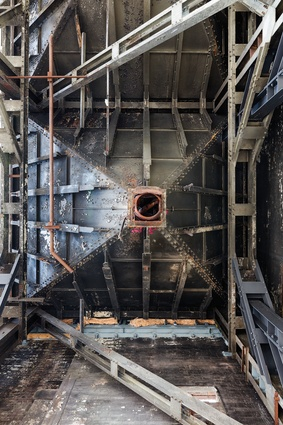 Looking up at the inverted steel pyramids that are the existing coal hoppers, which previously supplied coal to the boilers located below them.