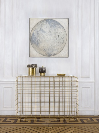 The painting is <em>Lune Blanche</em> by Denis Perrollaz. The brass console is the Cottos model, designed by Jean-Louis Deniot for Pouenat. The brass and ceramic vases are by Sophie Dries.