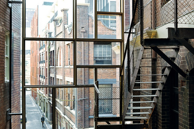TZG stitched the two historic buildings together by creating a glass atrium. Irregular patterned glazing clads the new space.