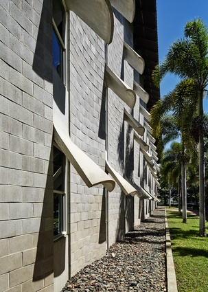 The material rhetoric of the building draws on the legacy of James Birrell's work at the JCU Townsville campus, including the Humanities and Administration Building (now the Ken Back Chancellery).