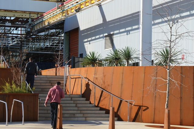 The design surrounding and beyond the MAB includes custom Corten steel planting pits and stepped and ramped entrances with varied paving.