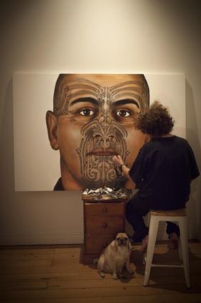 Artist Owen Dippie working on one of his paintings.